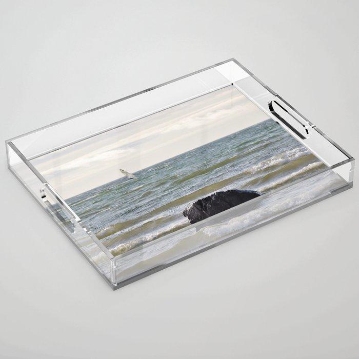 Windsurfer and black stone at gray sea Acrylic Tray