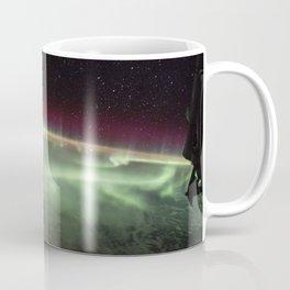 The Earths aurora was take on board the International Space Station on June 25, 2017 Coffee Mug