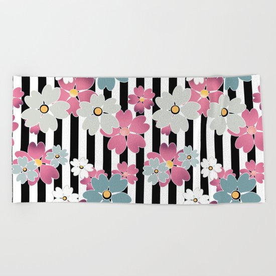 The floral pattern on striped background. Beach Towel
