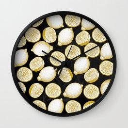 Lemons on black background Wall Clock
