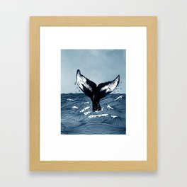 Hump Back Whale tail breaking the surface of stormy waves at sea Framed Art Print