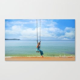 Woman relaxing on a swing on the beach , koh Samui, Suratthani, Thailand Canvas Print