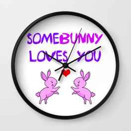 Some bunny loves you wordplay. Funny animal pun. Two little playful cute pink bunnies and red heart Wall Clock