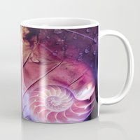 fibonacci Mugs featuring SHELTERED - Conceptual Composing with shell, leaf and waterdrops by INA FineArt