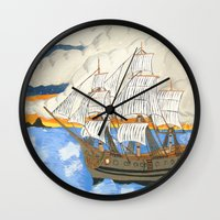 pirate ship Wall Clocks featuring Pirate Ship At Sea by J&C Creations