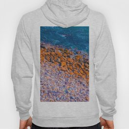 ocean with blue water and rock and stone Hoody