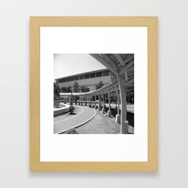 Black and white curve of the road with the roof Framed Art Print