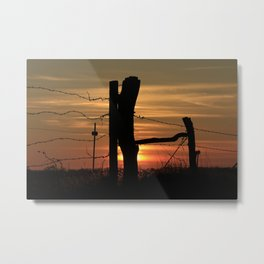 Kansas Colorful Sunset with a Barb wire Fence Silhouette. Metal Print
