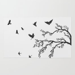 flock of flying birds on tree branch Rug