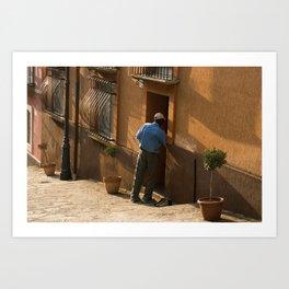 Man in a Blue Shirt Next to an Orange House Art Print