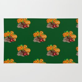 pumpkins apples and sunflowers on a green background Rug