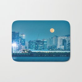 Super Moon over city skyline Bath Mat