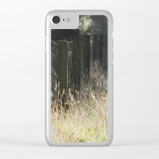 Fence and wild grass growing beside a track. Norfolk, UK. Clear iPhone Case
