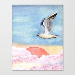 Seagull flying over pastel clouds Canvas Print