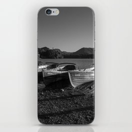 a black and white image of rowing boats moored at derwentwater iPhone Skin