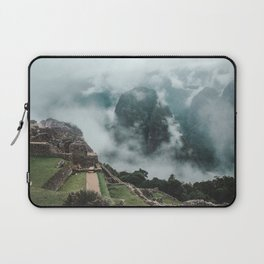 Ancient Inca ruins of Machu Picchu and surrounding Andes mountains on a misty morning Laptop Sleeve