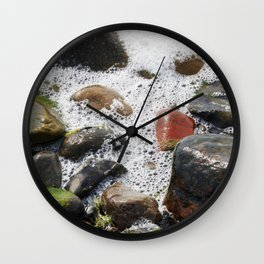Colorful stones washed by the foaming water on the beach Wall Clock