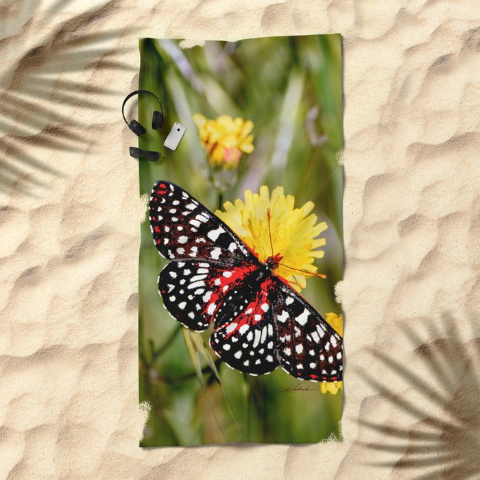 A Red Dotted Checkerspot Beach Towel