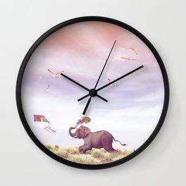 Elephant running after a kite Wall Clock