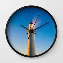 Lighthouse at night Wall Clock