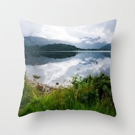 Low hanging clouds in the highland Throw Pillow