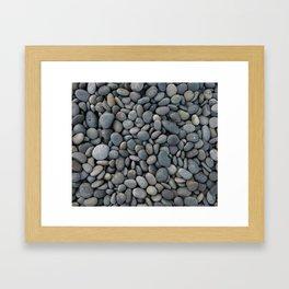 Gray pebbles Framed Art Print