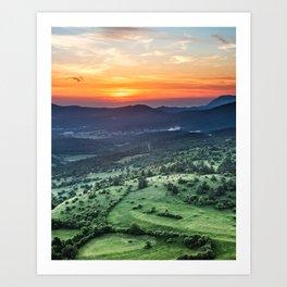 Beautiful sunset behind green fields Art Print