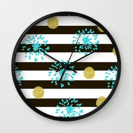 A festive mood. Striped background black and white with blue fireworks and Golden peas . Wall Clock