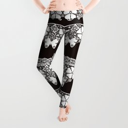 White lace Butterfly on a dark brown background . Leggings