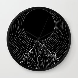 The dark sun over the mountains Wall Clock