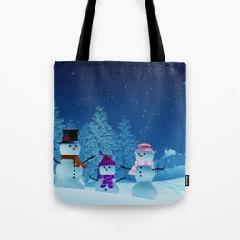 Snowman family in a moonlit winter landscape at night Tote Bag