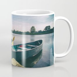 Canoe and Row Boat tethered on the River Thames Coffee Mug