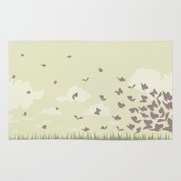 flying butterflies on a green landscape with sun Rug