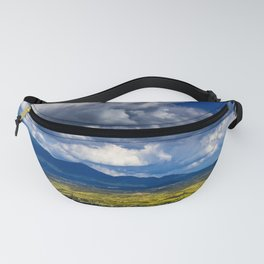 Beautiful rural view of the mountains of Tuscany in Italy. Cultivated grasslands Cloudy sky that let Fanny Pack