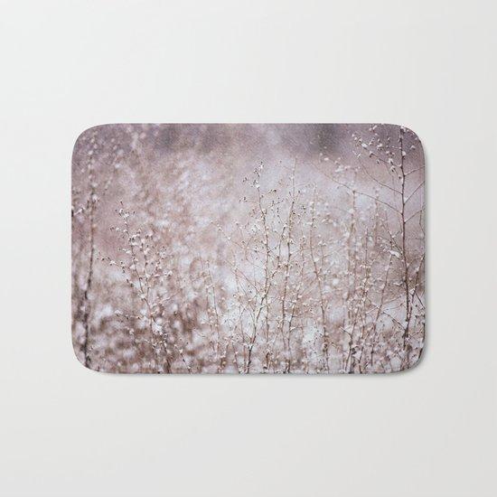 Snowy branches in the rain Bath Mat