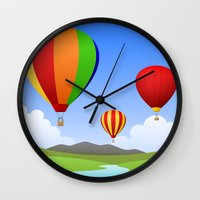 hot air balloons Wall Clocks featuring Hot Air Balloons by Henry Meadowlark