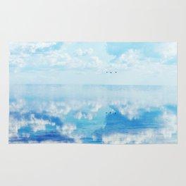 Ducks over sea Rug