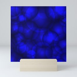 Glowing blue soap circles and volume sea bubbles of air and water. Mini Art Print