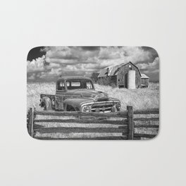 Black and White of Rusted International Harvester Pickup Truck behind wooden fence with Red Barn in Bath Mat