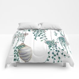 hanging plant in seashell Comforters