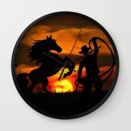 Cowboy at sunset Wall Clock