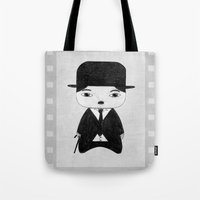alisa burke Tote Bags featuring A Boy - Charlie Chaplin (B&W) by Christophe Chiozzi