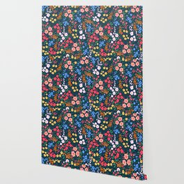 Vintage floral background. Flowers pattern with small colorful flowers on a dark blue background.  Wallpaper