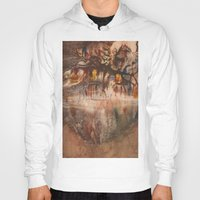 middle earth Hoodies featuring Middle of the Earth by Loredana