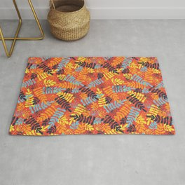 Leave Silhouettes blue, orange, yellow on red Rug