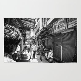 People walking in a street in Old Delhi, India Rug