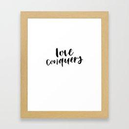 Love Conquers Framed Art Print