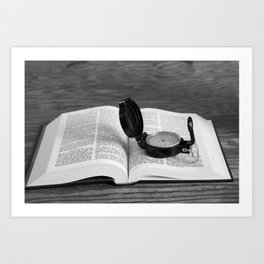 Seeking direction with open Bible and compass Art Print