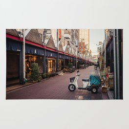 White scooter on the street Rug