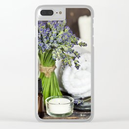 Fresh  lavender flowers, zen stones, essential oil, candle and towel over wooden surface Clear iPhone Case